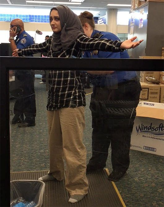 A TSA officer searches Zainab at the airport in Orlando