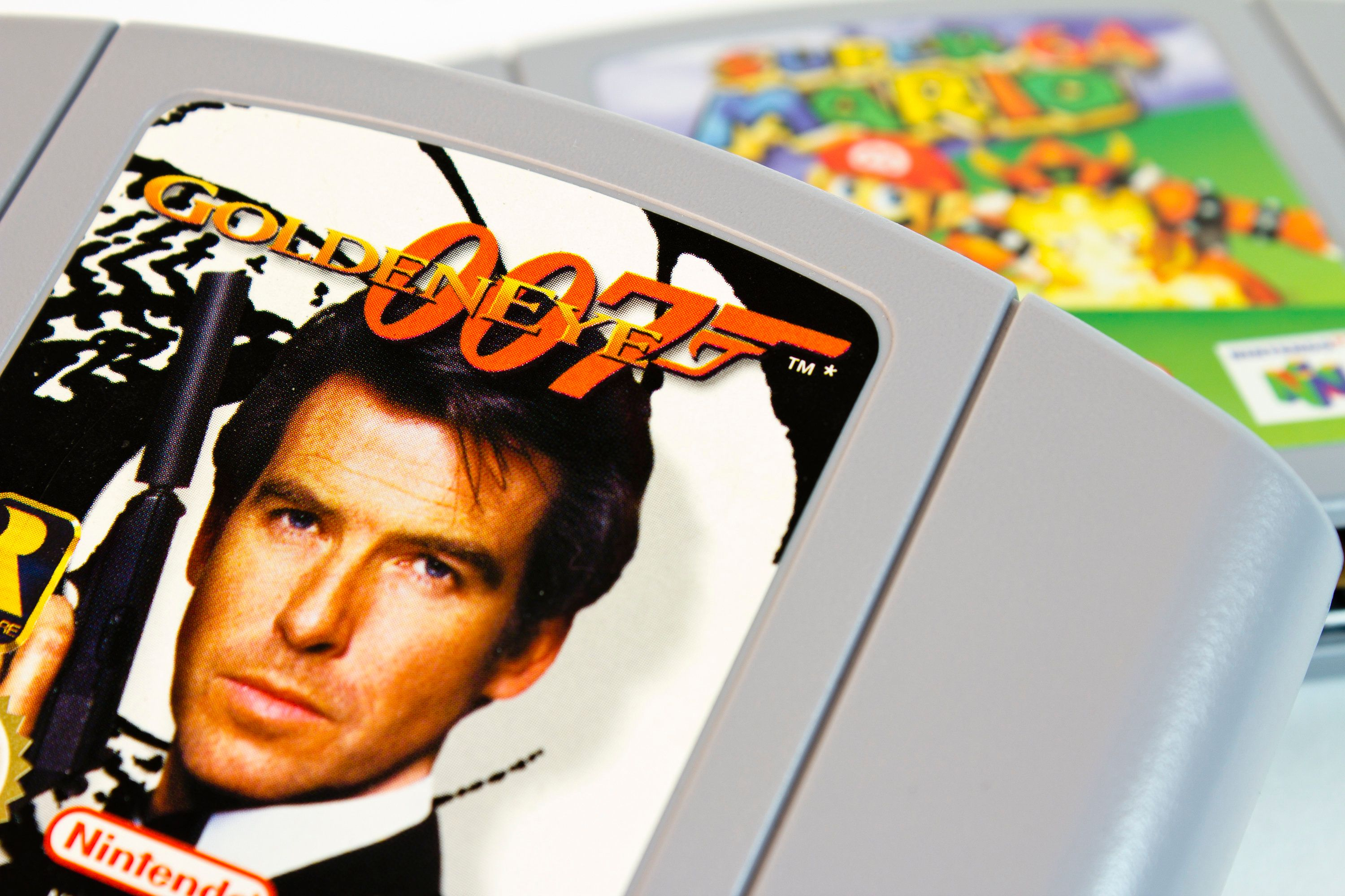 'Gothenburg, Sweden - April 15, 2011: Studio shot of the very popular Nintendo 64 game 007 Goldeneye, with Super Mario 64 in the background.'