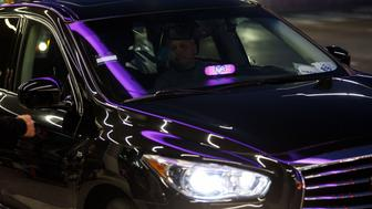 An illuminated Lyft Inc. sign is seen on the dashboard of a ride share vehicle at Los Angeles International Airport (LAX) in Los Angeles, California, U.S., on Monday, Nov. 13, 2017. Lyft Inc. has gained significant ground on its rival, Uber Technologies Inc., and is expected to grab more market share in the U.S., according to a private Lyft investor document obtained by Bloomberg. Photographer: Patrick T. Fallon/Bloomberg via Getty Images