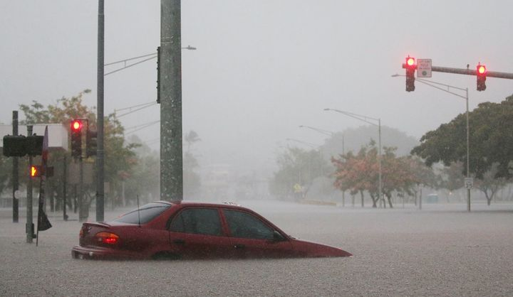 A car is partially submerged in floodwaters from Hurricane Lane rainfall on the Big Island in Hilo, Hawaii, on Thursday.