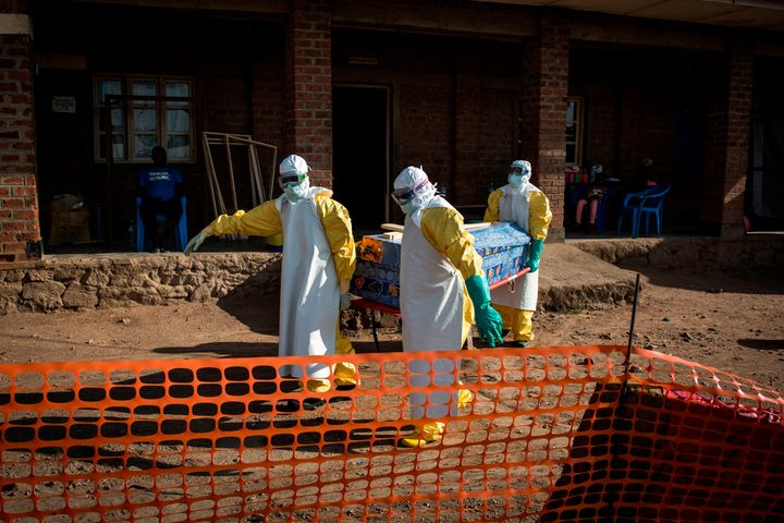 Medical workers carry the corpse of an unconfirmed Ebola case on Aug. 13, 2018, in the city of Beni in the Democratic Republi