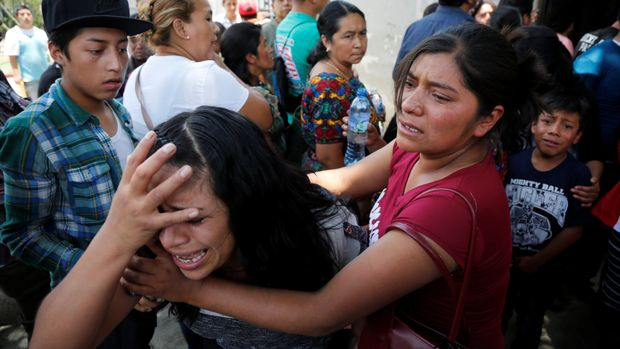 Guatemalan migrant Maria del Carmen Tambriz reacts after being returned from the U.S. without her daughter after they were separated by U.S. border officials in Guatemala city, Guatemala, July 26, 2018.  REUTERS/Luis Echeverria