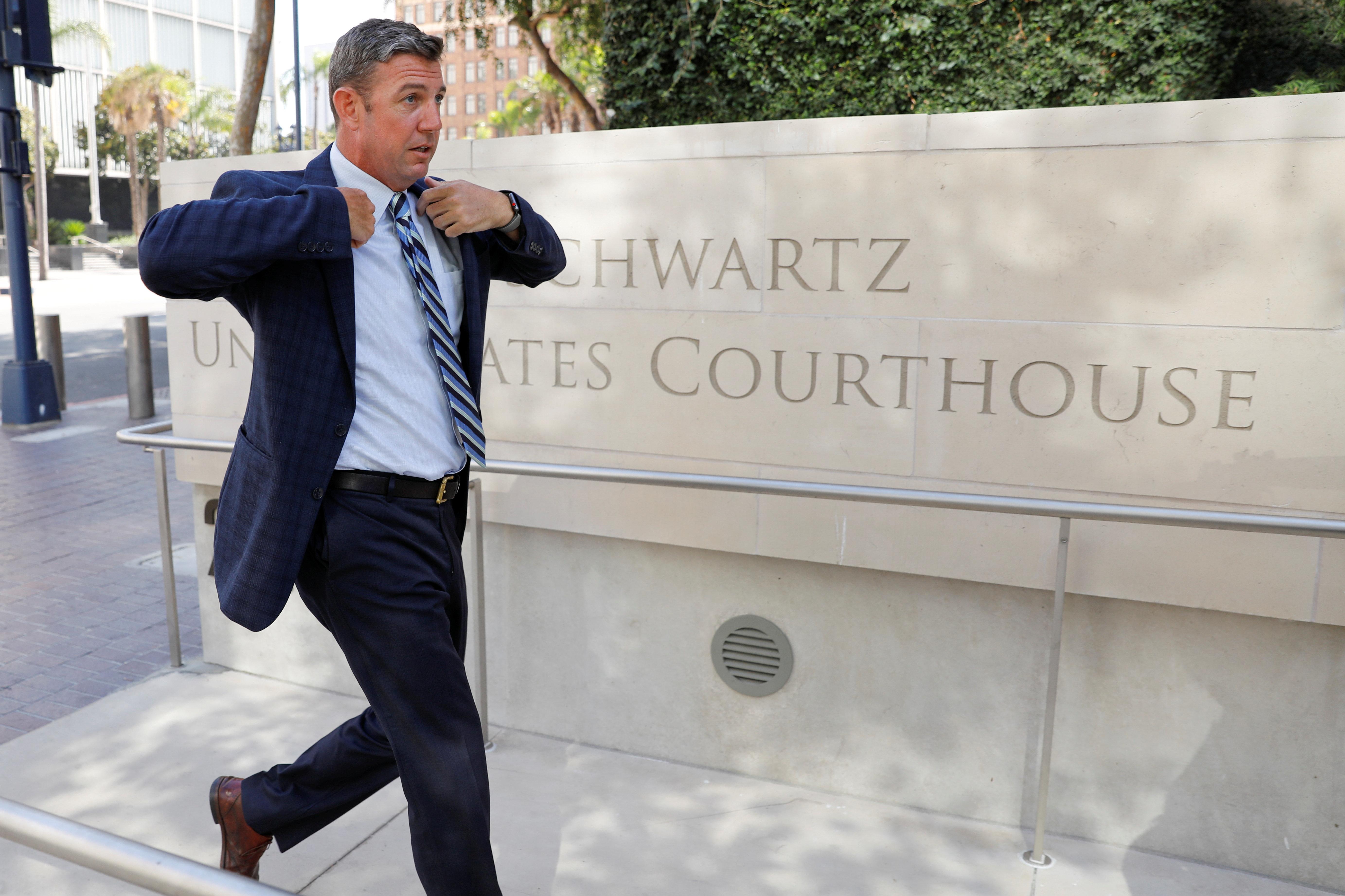 Congressman Duncan Hunter (R-CA) arrives for his arraignment at federal court in San Diego, California, U.S. August 23, 2018.        REUTERS/Mike Blake