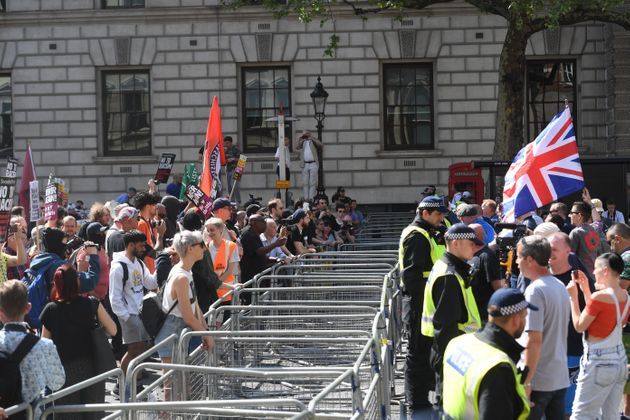 A demonstration by the Democratic Football Lads Alliance (right) and a counter protest near the Cenotaph,...