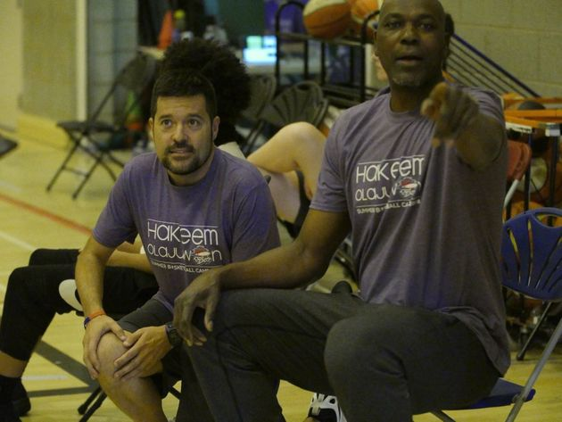 Basketball legend Hakeem Olajuwon calling the shots at his basketball camp for youths in