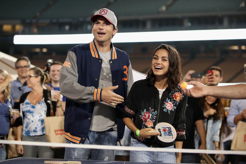 LOS ANGELES, CA - AUGUST 23:  (L-R) Ashton Kutcher and Mila Kunis play ping pong at  Clayton Kershaw's 6th Annual Ping Pong 4