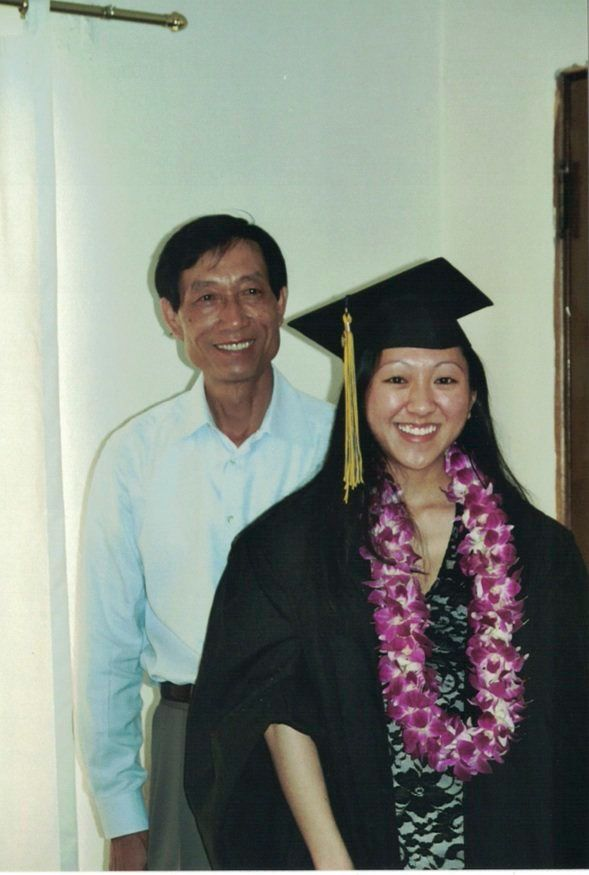The author and her father at her college graduation.