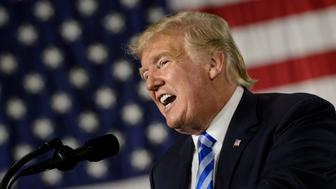 US President Donald Trump speaks during a signing ceremony for the John S. McCain National Defense Authorization Act for Fiscal Year 2019 at Fort Drum, New York, on August 13, 2018. (Photo by Brendan Smialowski / AFP)        (Photo credit should read BRENDAN SMIALOWSKI/AFP/Getty Images)