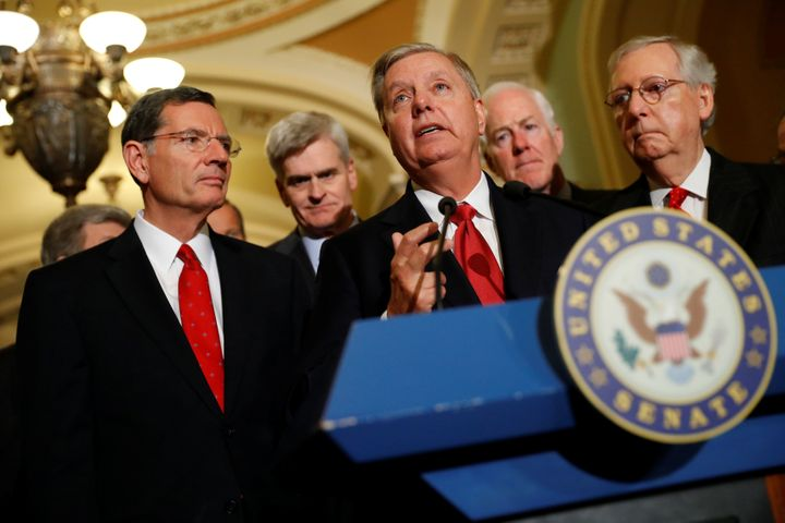 GOP Sens. John Barrasso (Wyo.), Bill Cassidy (La.) and Lindsey Graham (S.C.) — three sponsors of the new bill — with Senate Majority Leader Mitch McConnell (Ky.) and Majority Whip John Cornyn (Texas), after a failed attempt to weaken pre-existing condition protections last year.