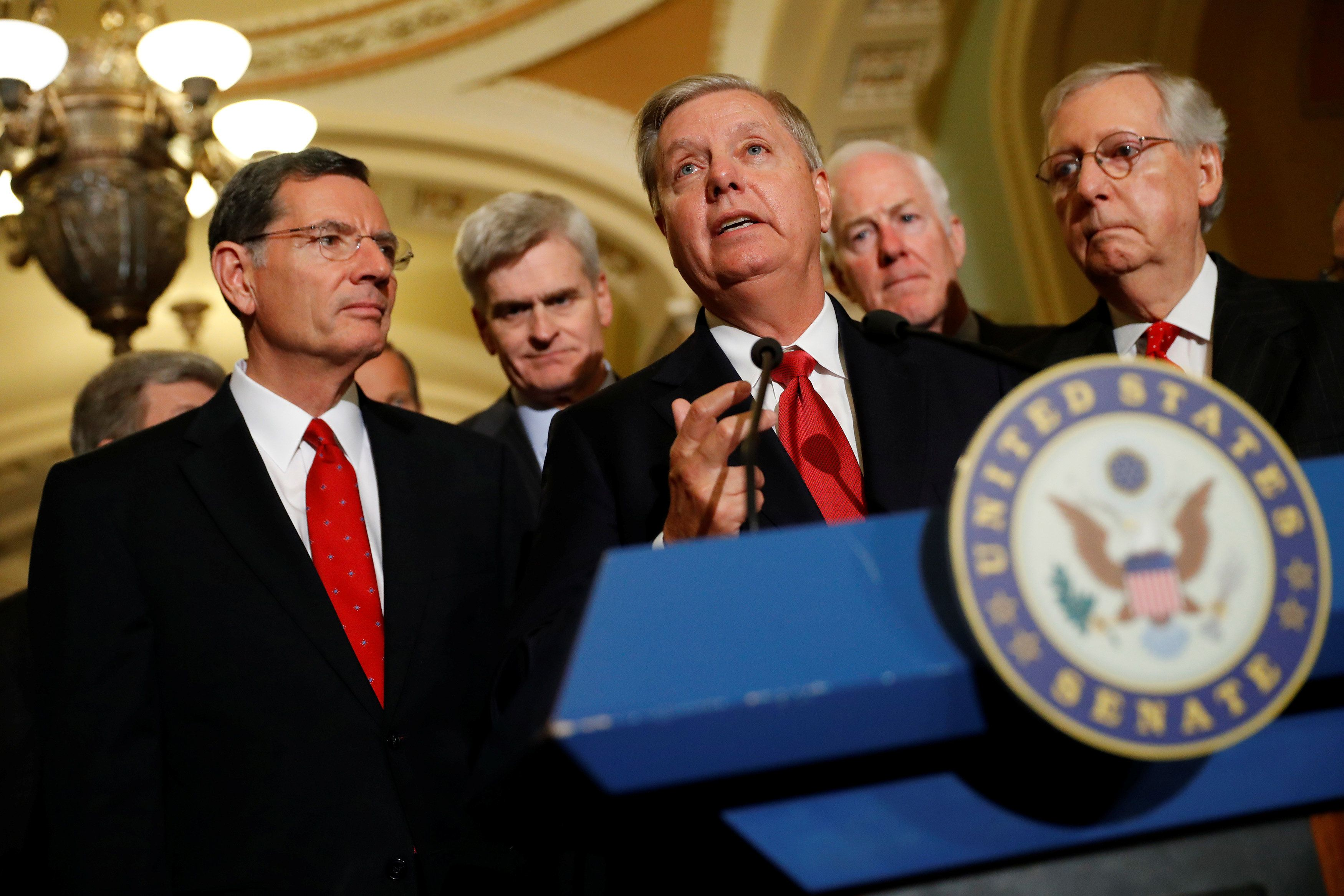 Sen. Lindsey Graham (R-SC), accompanied by (L-R) Sen. John Barrasso, Sen. Bill Cassidy (R-LA), Sen. John Cornyn (R-TX) and Senate Majority Leader Mitch McConnell, speaks with reporters following the party luncheons on Capitol Hill in Washington, U.S., September 26, 2017. REUTERS/Aaron P. Bernstein