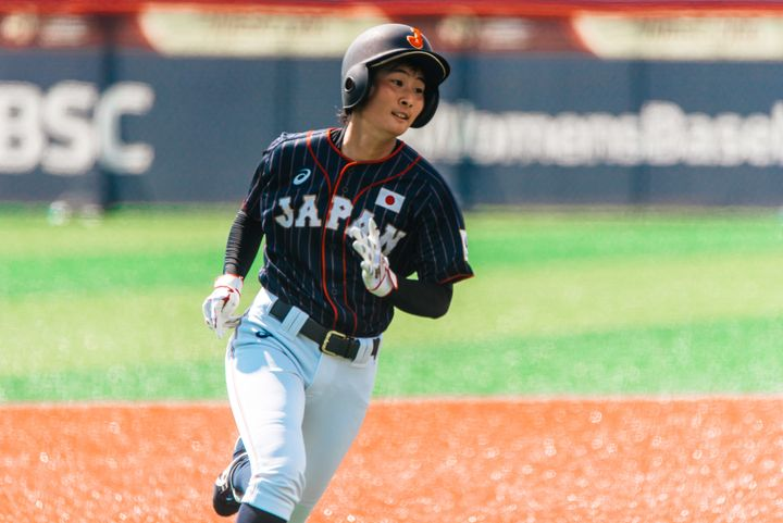 Japan'sHarue Yoshi rounds the bases during the Women's Baseball World Cup in a game against Hong Kong in Viera, Florida