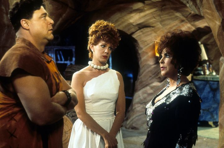 "John Goodman, Elizabeth Perkins and Elizabeth Taylor in ""The Flintstones."""