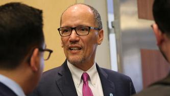 Democratic National Committee Chairman Tom Perez talks with DNC staffers following an executive committee meeting at the Democratic National Committee (DNC) Summer Meeting in Chicago, Illinois, U.S., August 23, 2018.  REUTERS/Daniel Acker