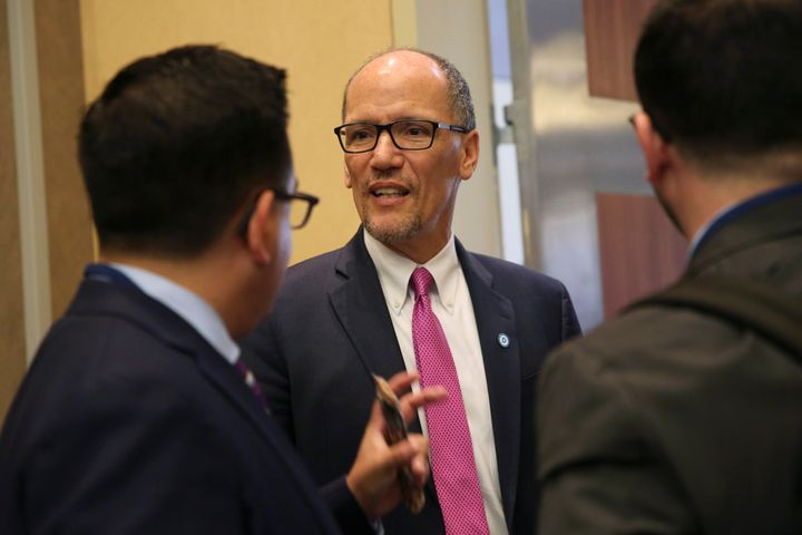 Democratic National Committee Chairman Tom Perez talks with DNC staffers following an executive committee meeting Thursday in