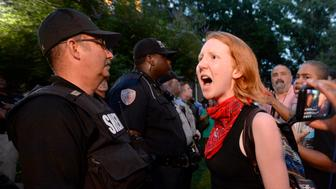 CHAPEL HILL, NC - AUGUST 22:  A demonstrator yells at a sheriff deputy during a rally for the removal of a Confederate statue, coined Silent Sam, on the campus of the University of Chapel Hill on August 22, 2017 in Chapel Hill North Carolina.  (Photo by Sara D. Davis/Getty Images)