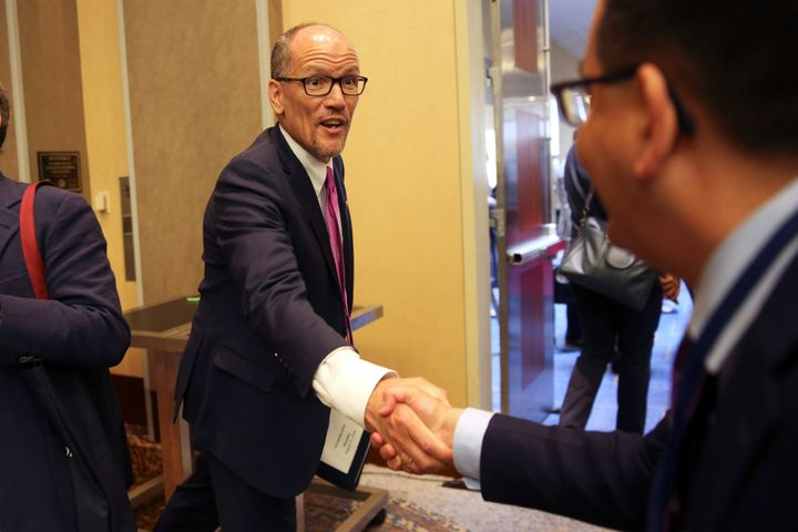 Democratic National Committee Chairman Tom Perez greets a staffer following an executive committee meeting in Chicago on Aug.