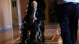 WASHINGTON, DC - DECEMBER 01:  U.S. Sen. John McCain (R-AZ) passes by on a wheelchair in a hallway at the Capitol December 1, 2017 in Washington, DC. Senate GOPs indicate that they have enough votes to pass the tax reform bill.  (Photo by Alex Wong/Getty Images)