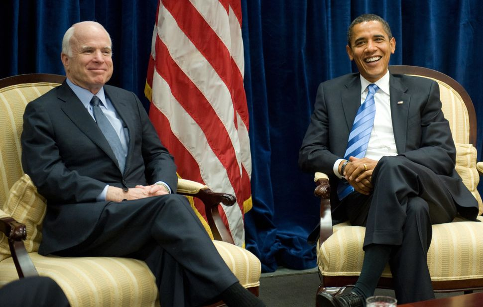 Barack Obama, at the time the president-elect of the U.S., meets with his former GOP rival McCain at Obama's transition offic