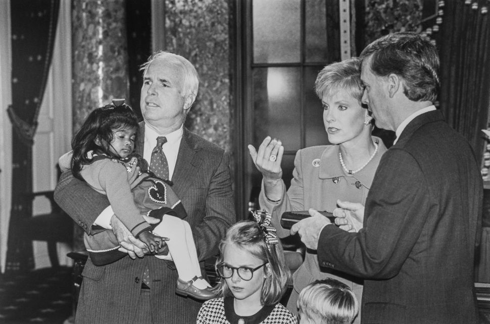 McCain, holding recently adopted Bridget, with wife Cindy Hensley, Vice President Dan Quayle and daughter Meghan during Mock