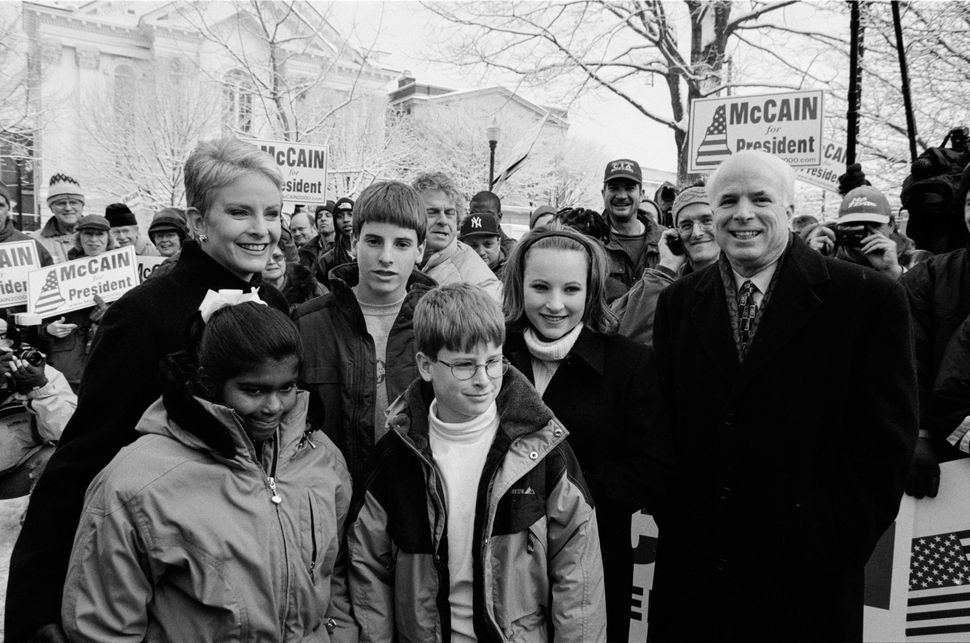 McCain at a rally in the park with his family: daughter Bridget, wife Cindy, sons Jack and Jimmy, and daughter Meghan, on Jan