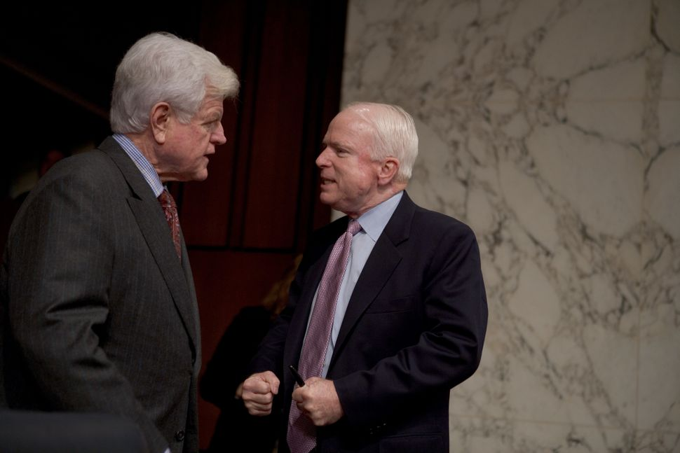 Sen. Ted Kennedy (D-Mass.) confers with McCain before the start of a Senate Armed Services Committee hearing on Capitol Hill