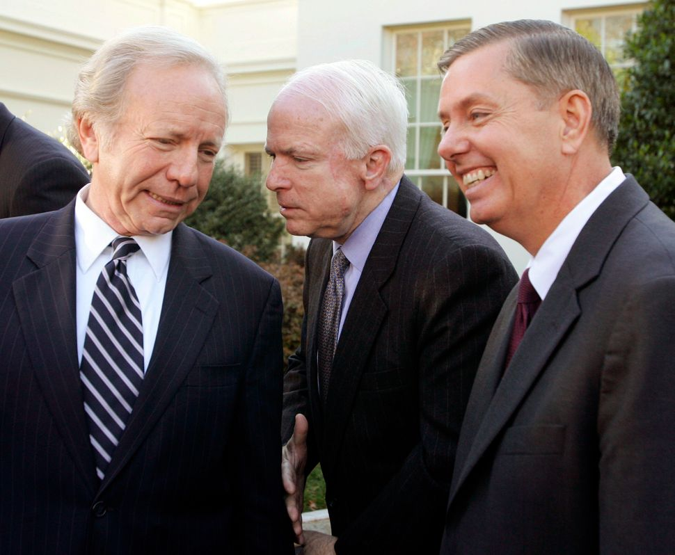 McCain confers with Sens. Joe Lieberman (D-Conn.) and Lindsey Graham (R-S.C.) during remarks to the press outside the West Wi