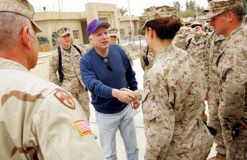 McCain talks with Marines at Camp Fallujah outside of Fallujah, Iraq.