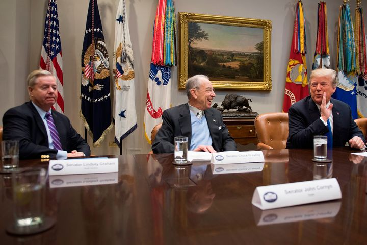 President Donald Trump jokes with Senator Chuck Grassley (R-Iowa) and Sen. Lindsey Graham (R-S.C.) during a meeting at the Wh