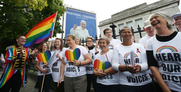 An LGBT choir protests outside the world meeting of families in