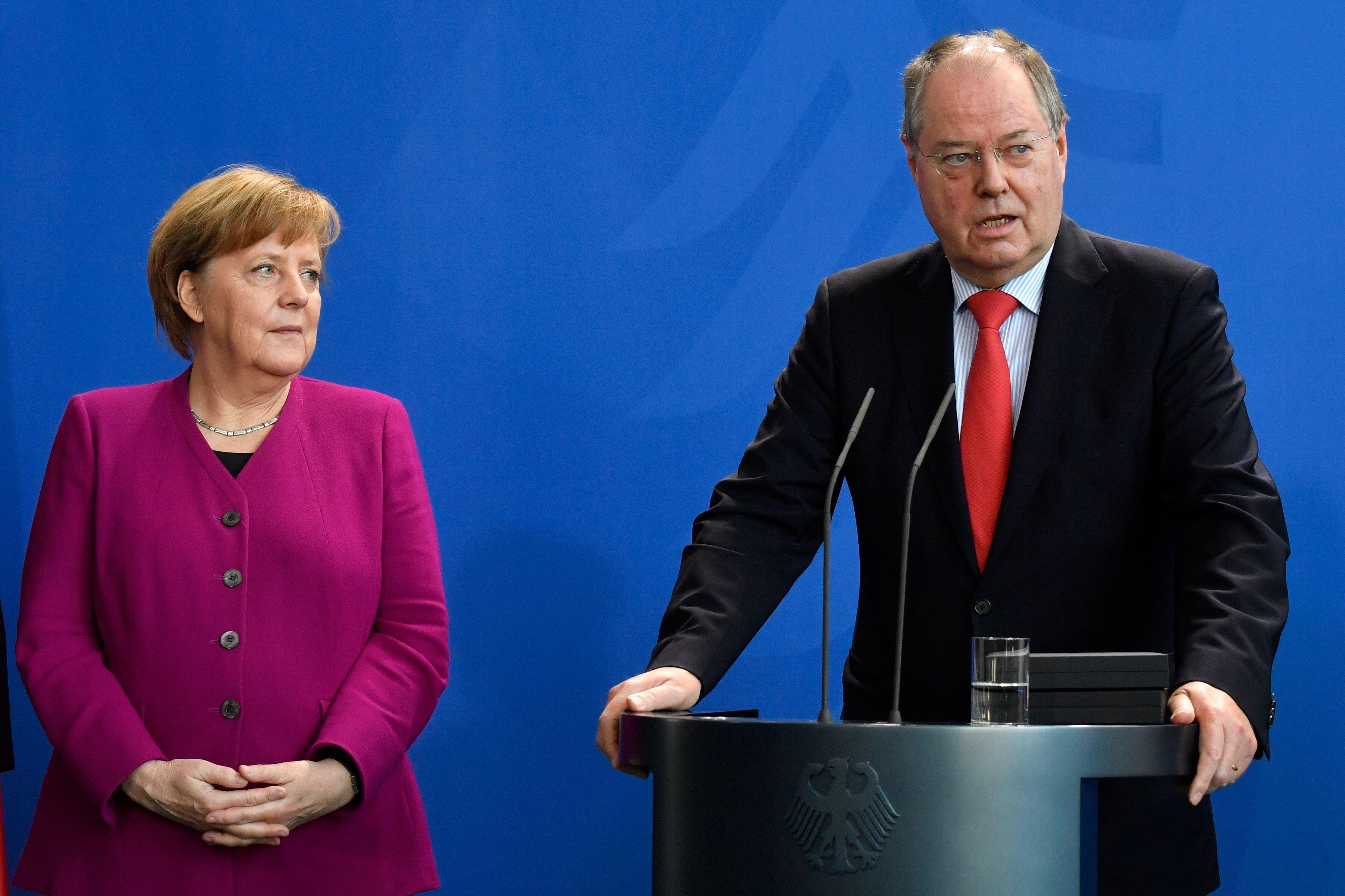 Angela Merkel und Peer Steinbrück bei einem Auftritt im Februar