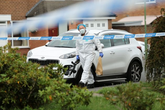 A police forensic officer outside a property on Northdown Road in