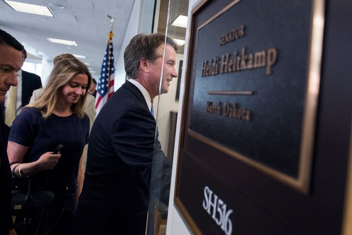 Brett Kavanaugh arrives at Sen. Heidi Heitkamp's office to meet with her before his Supreme court nomination hearings. A grou