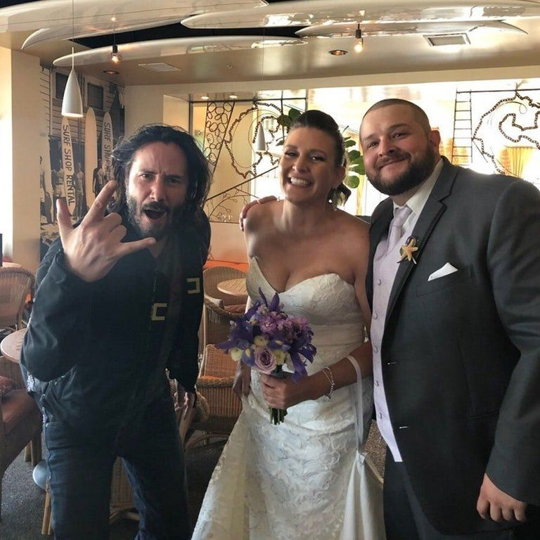 Keanu Reeves making this lucky couple's wedding album 100 times more enjoyable.