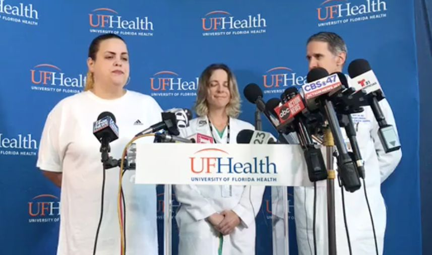 Sujeil Lopez (far left), Timothy Anselimo's mother, speaks at a press conference the day after he was shot at an esports tournament in Jacksonville, Florida, on Aug. 26.