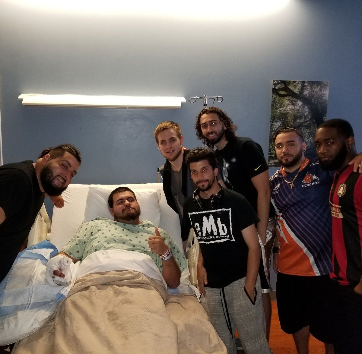 A photo shared by Sujeil Lopez shows her son 26-year-old Timothy Anselino recovering in the hospital following Sundays shooting