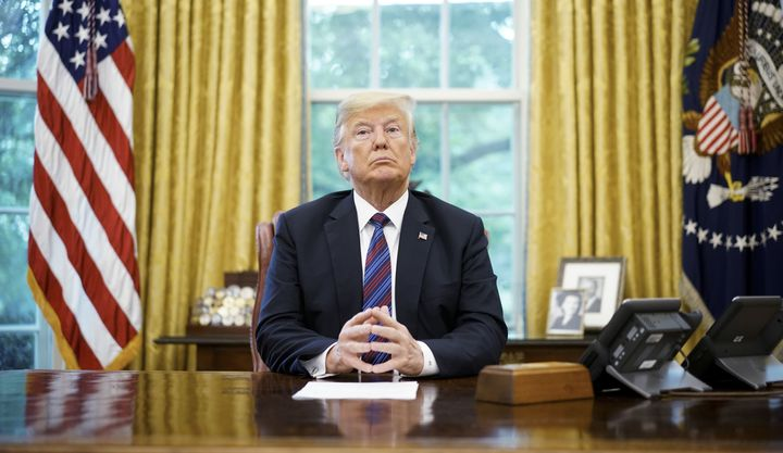 President Donald Trump speaks on the phone with Mexico's President Enrique Pena Nieto on trade in the Oval Office of the Whit