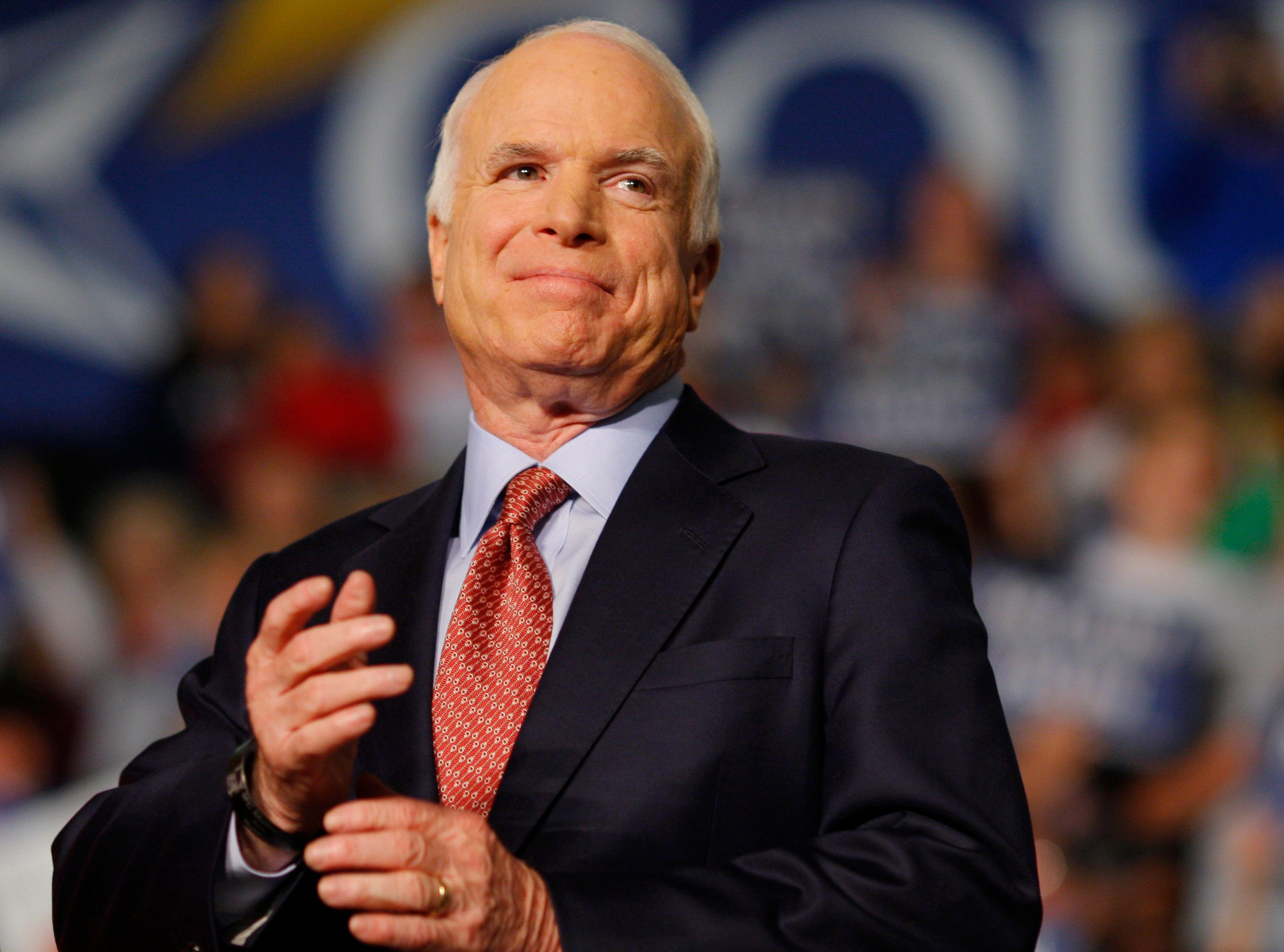 U.S. Republican presidential nominee Senator John McCain (R-AZ) listens as he is introduced at a campaign rally in Dayton, Ohio October 27, 2008.   REUTERS/Brian Snyder    (UNITED STATES) US PRESIDENTIAL ELECTION CAMPAIGN 2008 (USA)