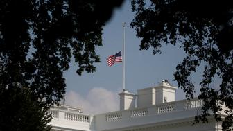 The White House flag is seen after being returned to half-staff in honor of Senator John McCain (R-AZ) after first being lowered on Sunday in his honor, then raised again just after midnight on Monday and then being returned to half-staff Monday afternoon at the White House in Washington, U.S., August 27, 2018.  REUTERS/Leah Millis