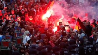 Right wing demonstrators light flares on August 27, 2018 in Chemnitz, eastern Germany, following the death of a 35-year-old German national who died in hospital after a 'dispute between several people of different nationalities', according to the police. - The far-right street movement PEGIDA called for a second day of protests in Chemnitz in ex-communist eastern Germany after the alleged fatal stabbing of a German man by a foreigner. (Photo by Odd ANDERSEN / AFP)        (Photo credit should read ODD ANDERSEN/AFP/Getty Images)