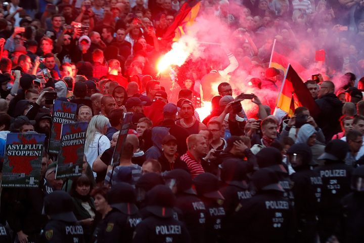 Right-wing demonstrators light flares on Aug. 27 in Chemnitz, Germany, following the death of a 35-year-old German natio
