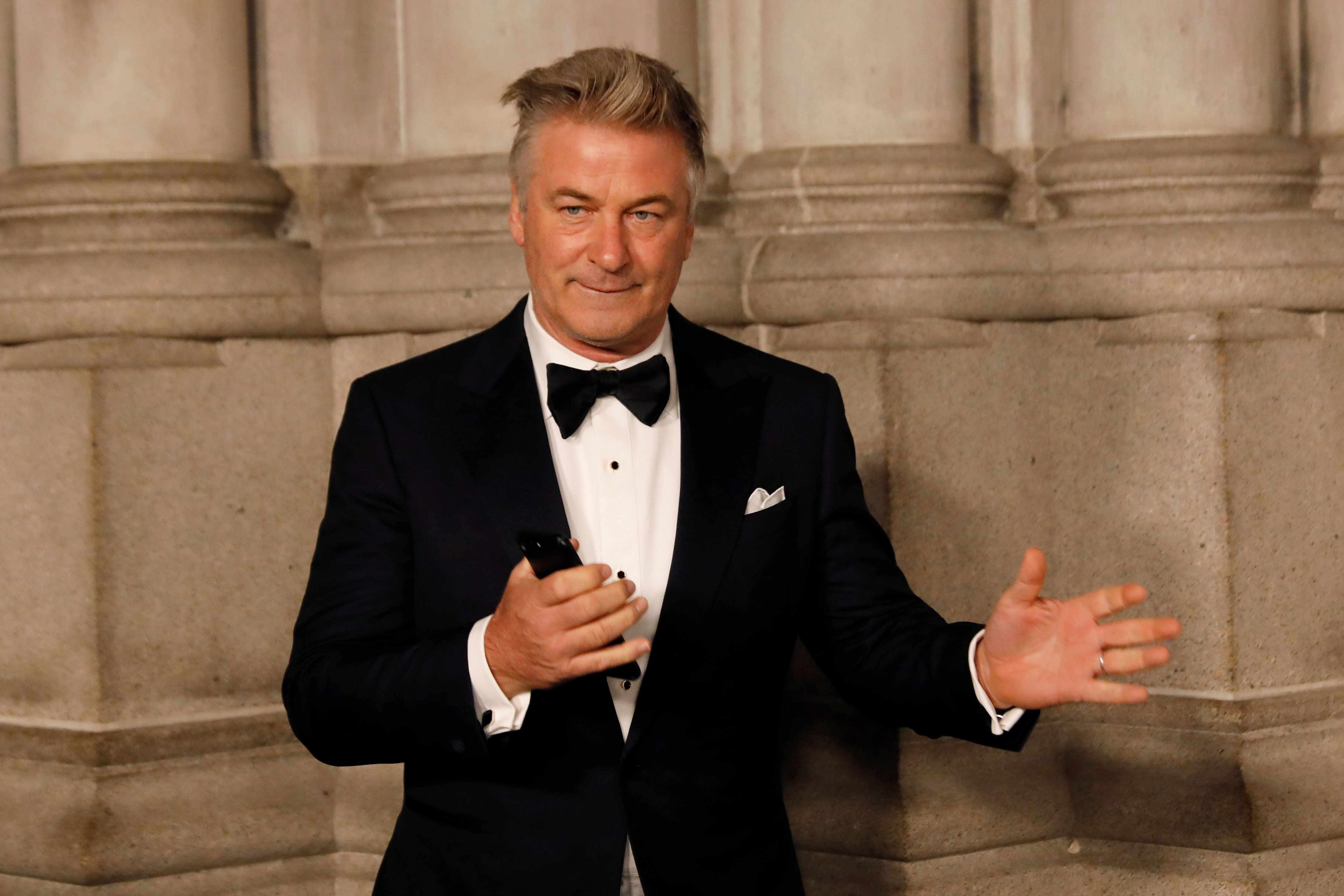 Actor Alec Baldwin gestures before walking on the red carpet during the commemoration of the Elton John AIDS Foundation 25th year fall gala at the Cathedral of St. John the Divine in New York City, in New York, U.S. November 7, 2017. REUTERS/Shannon Stapleton