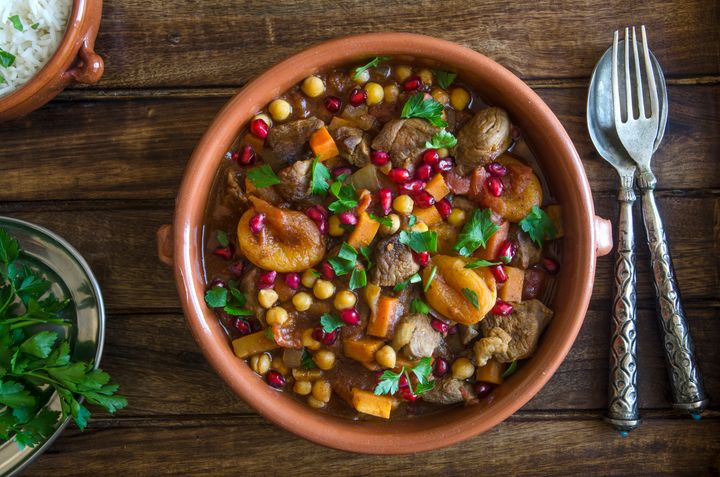 Lamb tagine with chickpeas, apricots and pomegranate seeds.