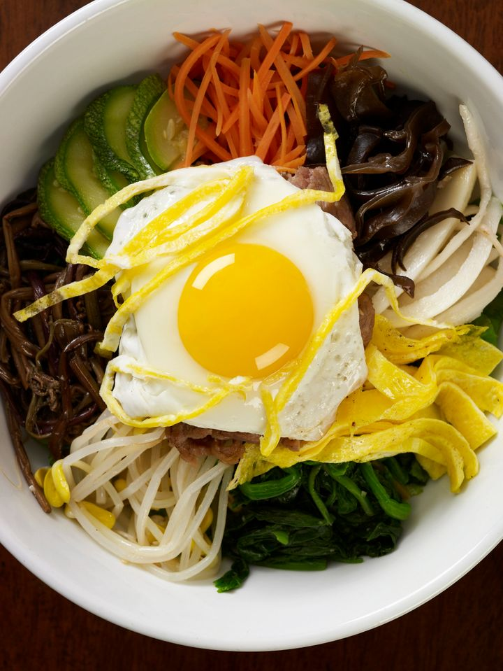 Bibimbap with fried egg and vegetables.