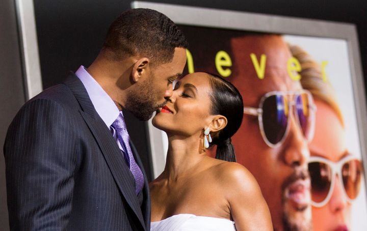 """Will Smith and Jada Pinkett Smith kiss at the premiere of """"Focus"""" in Hollywood on Feb. 24, 2015."""