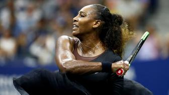 NEW YORK, NY - AUGUST 27:  Serena Williams of the United States returns the ball during her women's singles first round match against Magda Linette of Poland on Day One of the 2018 US Open at the USTA Billie Jean King National Tennis Center on August 27, 2018 in the Flushing neighborhood of the Queens borough of New York City.  (Photo by Julian Finney/Getty Images)