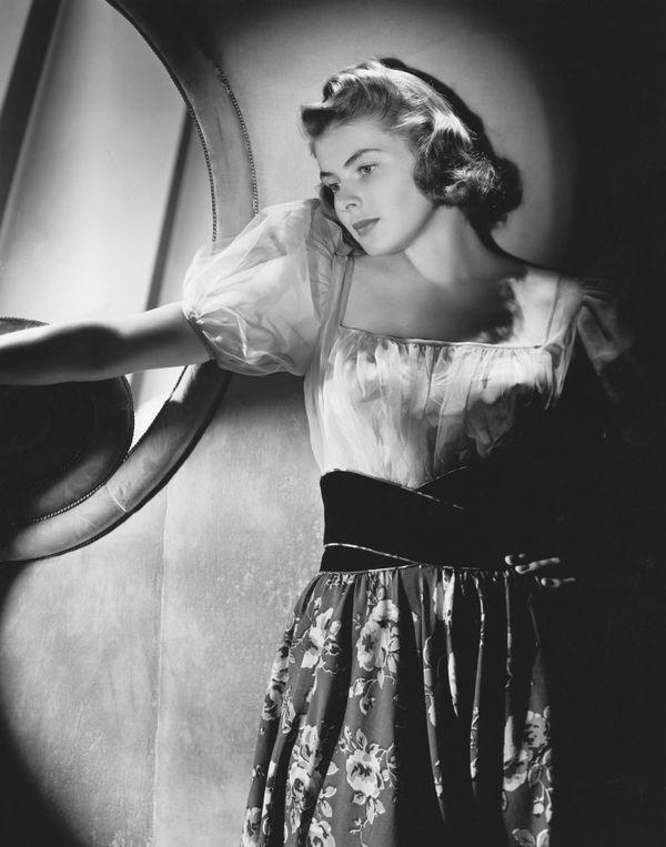 A portrait of Bergman in a printed dress.