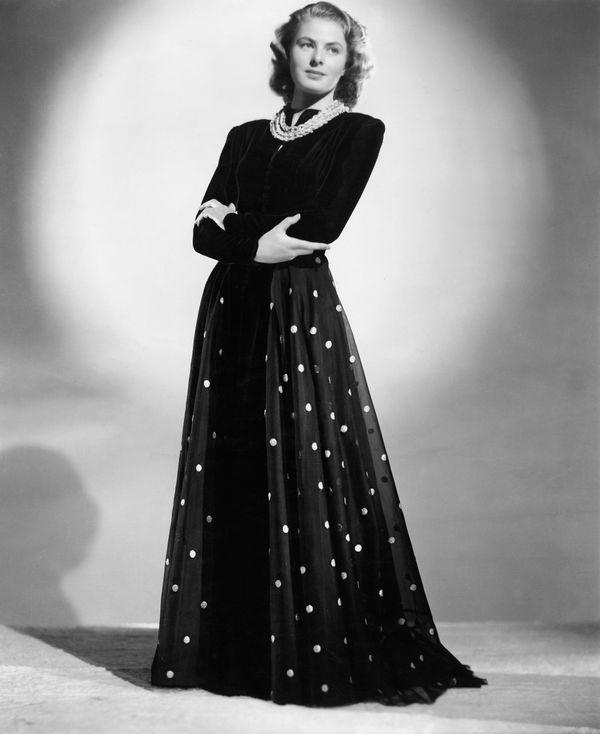 A portrait of Bergman in a black gown with polka dots.