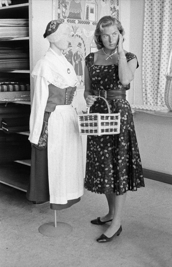 Bergman standing beside a mannequin with a typical folk dress of Ciociaria, Italy.