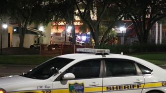 JACKSONVILLE, FL - AUGUST 27:  A Jacksonville Sheriff crime scene unit van is seen as law enforcement investigates a shooting at the GLHF Game Bar which uses the same entrance as the Chicago Pizza place (seen behind the van) at the Jacksonville Landing on August 27, 2018 in Jacksonville, Florida. The shooting occurred at the GLHF Game Bar during a Madden 19 video game tournament, with initial reports indicating three people dead, including the gunman, and several others wounded.  (Photo by Joe Raedle/Getty Images)