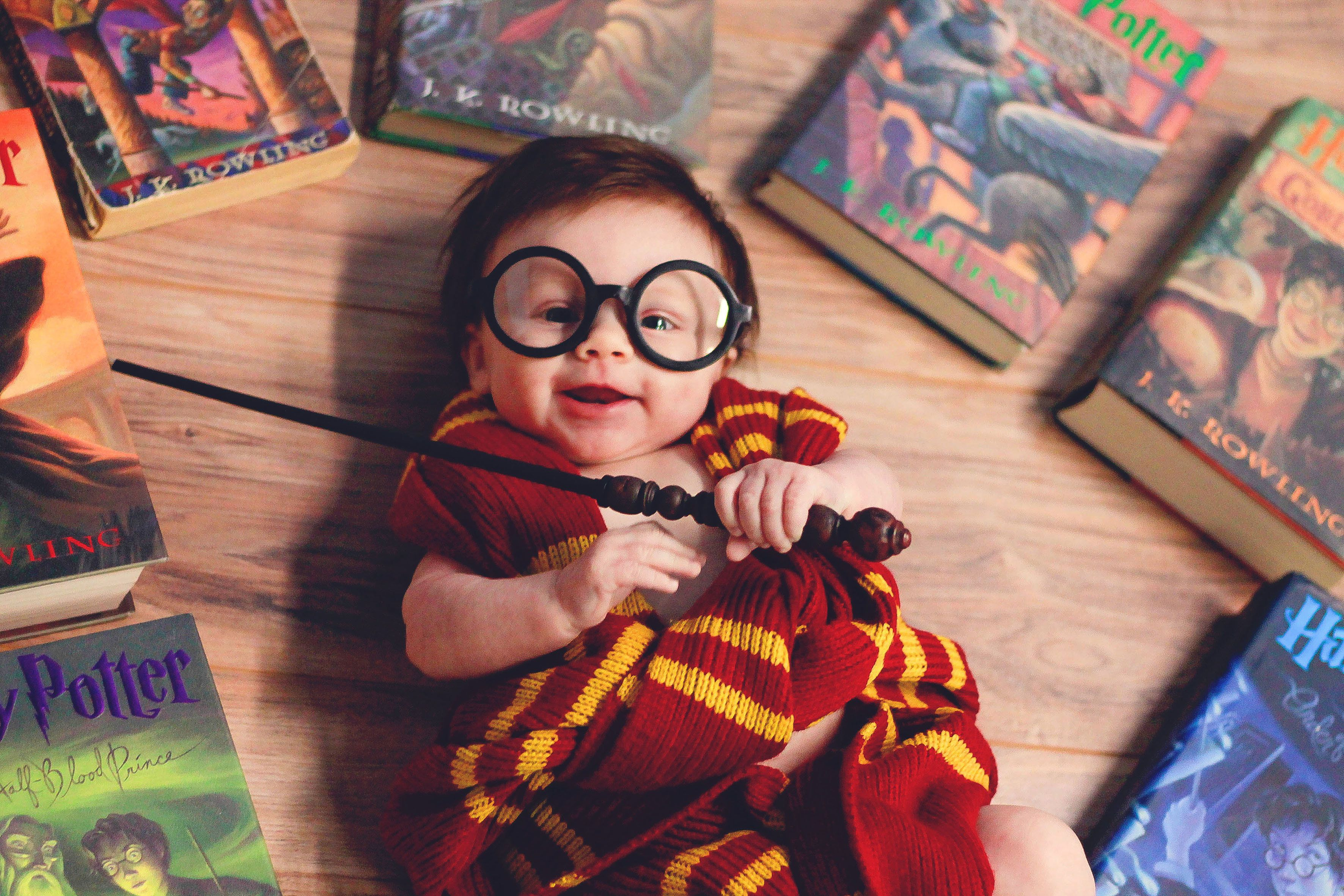 *** EXCLUSIVE ***  CHICAGO, IL - 2016: A four-month-old baby girl, Lorelai Grace is dressed as a baby Harry Potter during a photo shoot in Chicago, Illinois.  A DIE hard Harry Potter fan has created a magical photoshoot using her baby daughter. Photographer Kayla Glover, aged 29, of Illinois, put her vision of all things Harry Potter to the test after the birth of her daughter Lorelai Grace. The adorable youngster, who is now four-months-old, can be seen in one of the series of spellbinding photos- placed in a cauldron and wrapped in a Gryffindor scarf while adorned in the well known Harry Potter style glasses, complete with wand and wearing an expression almost as though she had just been told 'You're a wizard Lorelai'!  PHOTOGRAPH BY Fortitude Press / Barcroft Images  London-T:+44 207 033 1031 E:hello@barcroftmedia.com - New York-T:+1 212 796 2458 E:hello@barcroftusa.com - New Delhi-T:+91 11 4053 2429 E:hello@barcroftindia.com www.barcroftimages.com (Photo credit should read Fortitude Press /Barcroft Images / Barcroft Media via Getty Images)